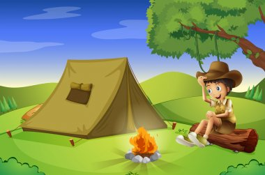 A boy with a tent and a camp fire