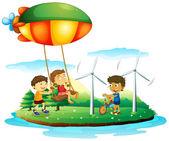 Fotografia tre bambini che giocano al parco