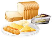 Fotografia pane a fette con formaggio e biscotti