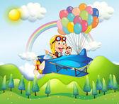 Fotografia due scimmie a cavallo in un aereo con palloncini colorati