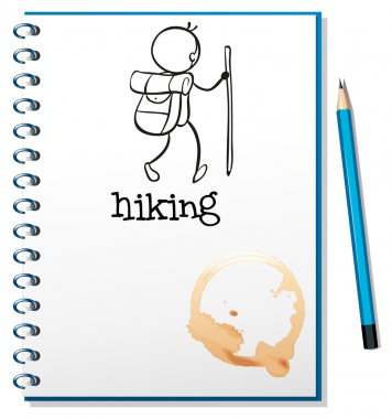 A notebook with a sketch of a person hiking