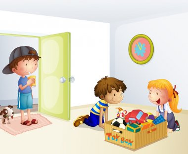 Three kids inside the house with a box of toys