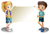 dívka a chlapec drží prázdný nápis