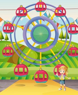 A girl below the ferris wheel