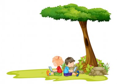A girl and a boy with laptops under the tree