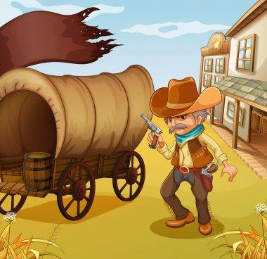 A Mexican man holding a gun beside a wagon