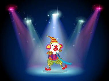 A clown at the stage with spotlights