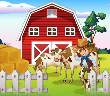 A cowboy inside the farm with cows and a barnhouse