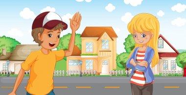 A boy and a girl talking across the neighborhood