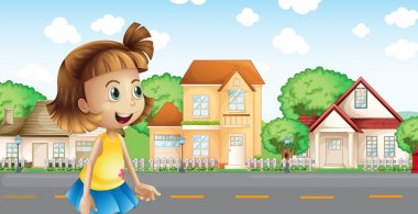A girl walking across the neighborhood