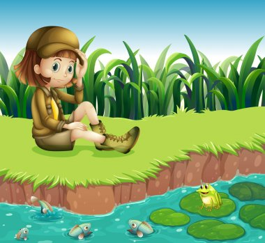 A girl wearing a hat sitting at the riverbank