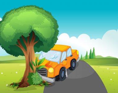 A car crash at the road with a big tree