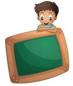 Fotografie ein Junge mit einem leeren Brett