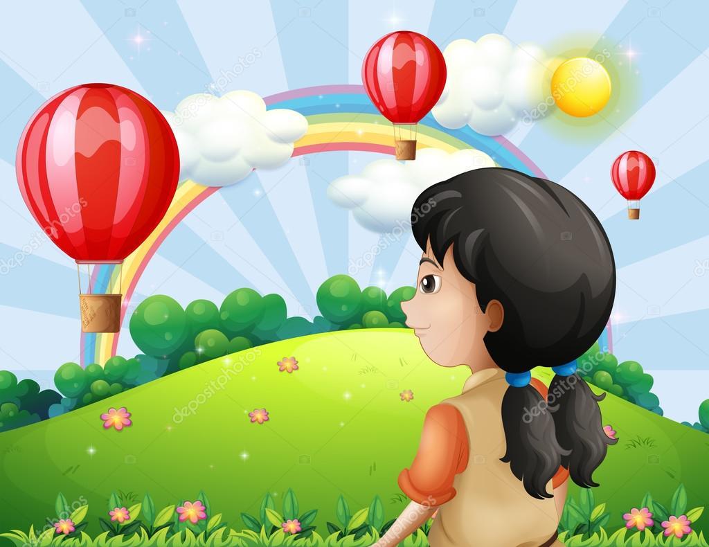 A girl looking at the hot air balloon