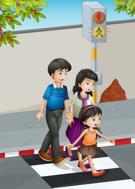 A family crossing the street