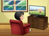 Fényképek Egy fiatal fiú nézi Tv a nappaliban