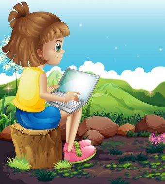 A young girl sitting above the stump while using the laptop