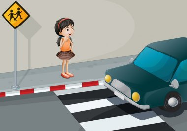 A little girl at the pedestrian lane