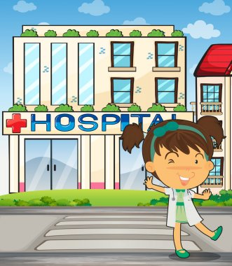 A smiling doctor in front of the hospital building