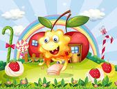 šťastné monstrum na vrcholku kopce s obří lízátka a apple ho