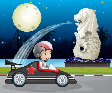 A car racer passing the street with the statue of Merlion