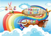 A happy Easter template with eggs and a bunny near the rainbow