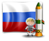 The flag of Russia at the back of an explorer beside the rocket