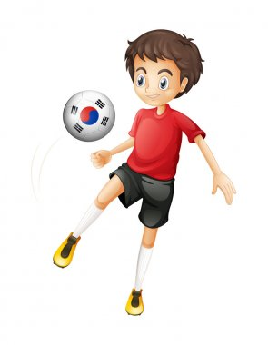 A smiling boy playing the ball with the flag of South Korea