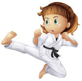 A brave young girl doing karate