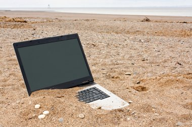 laptop personal computer on the beach