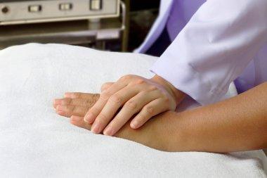 Doctor'hand helping senior's hand