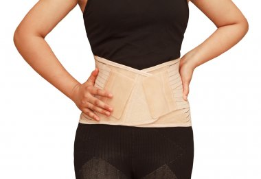 Woman wearing lumbar brace corset,back support for back truma