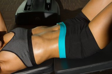 Close-up of the abdominal muscles young fitness woman