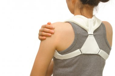 woman wearing clavicle brace for immobilize shoulder