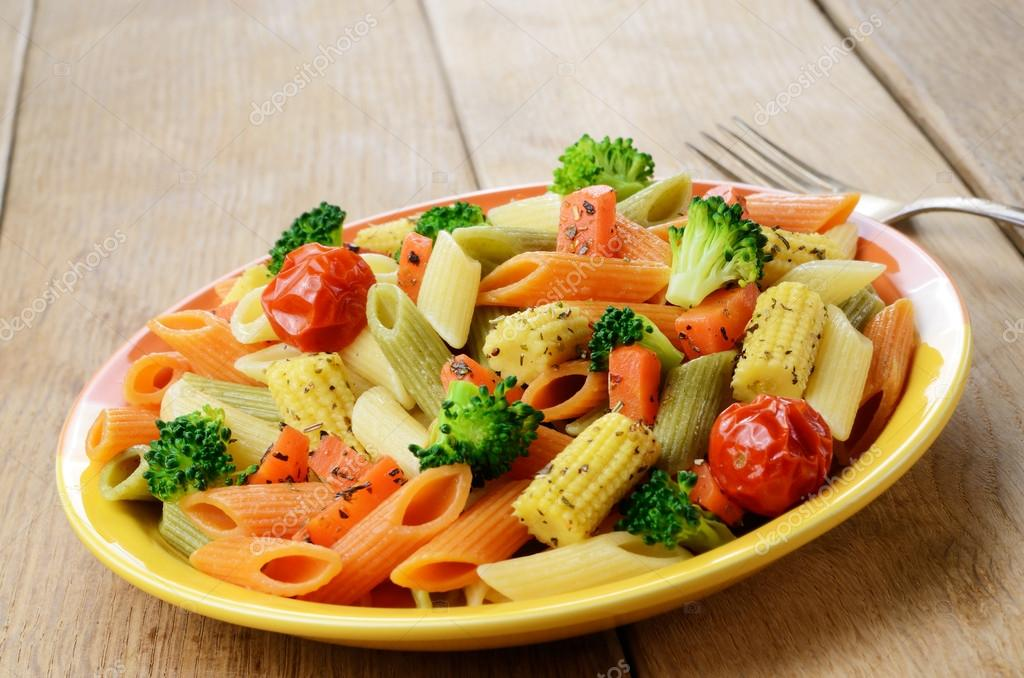 Pasta Penne Salad With Broccoli Carrot Corn And Tomatoes On T Stock
