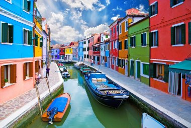 Venice, Burano island canal, small colored houses and the boats stock vector