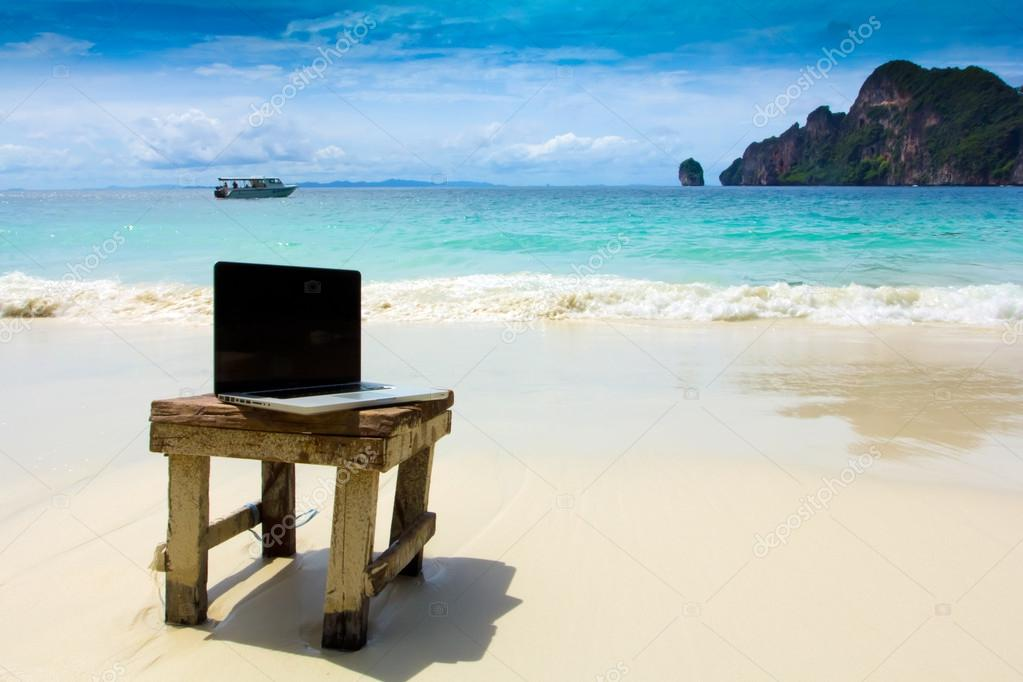 Computer notebook on beach