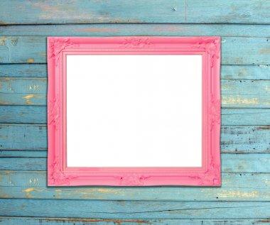 Pink Vintage picture frame on blue wood background