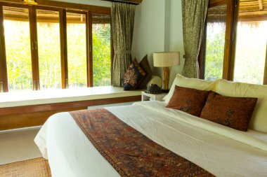 Rural style bedroom with canopy bed with sea view
