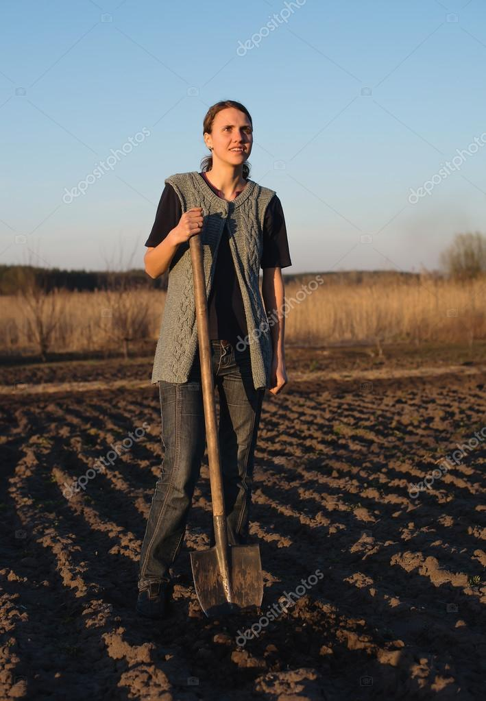 girl on field work the land at sunset