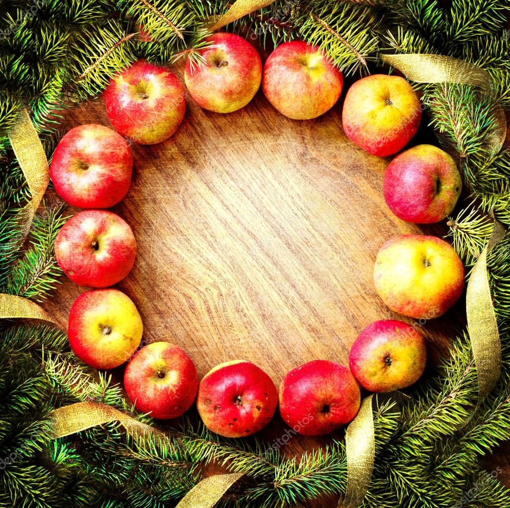 Christmas tree with apples and decorations on a wooden board — Stock ...