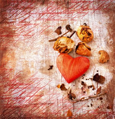 Heart as a symbol of love, vintage card with red heart and dry roses on grunge old background