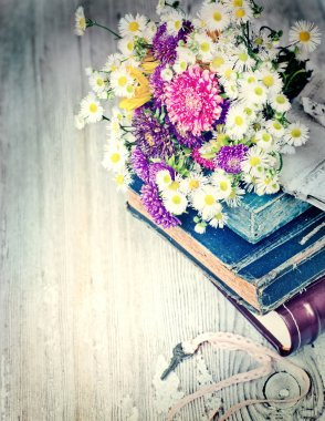 Books, flowers and key