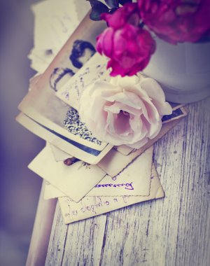 Roses with old letters and postcards
