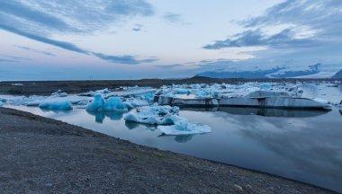 Blue icebergs floating