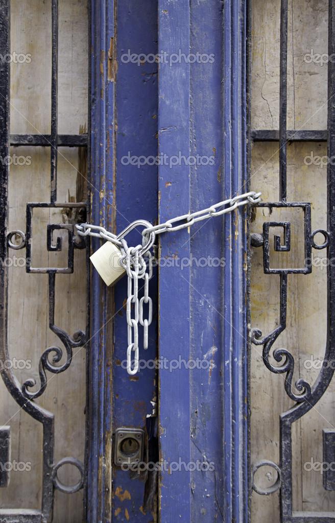Padlocked door \u2014 Stock Photo & Padlocked door \u2014 Stock Photo © esebene-photo #25382663