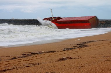 Waves & red ship
