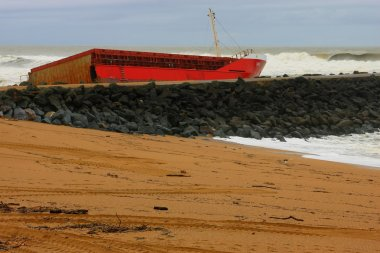 Red ship on the shore