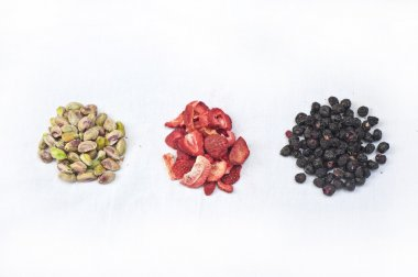 Pistachios, frozen dried strawberries and blueberrie