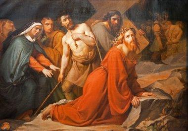 BRUSSELS - JUNE 21: Jesus under cross. Paint from church Notre Dame du Finstere by Albert Roberti on June 21, 2012 in Brussels.